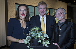 Kerry O'Brien, Emma Manea and Criminal Law Director Annmarie Lumsden stand around a table at the 2019 Criminal Law Conference.