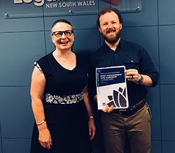 Director Civil Law Meredith Osborne and lawyer Matthew Lyster with the guidelines that will help reduce debt stress for ratepayers.
